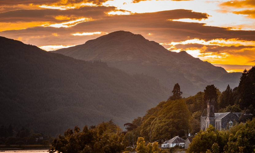 Argyll hills at sunset form the backdrop to the parish of Kilmun on the shores of the Holy Loch.